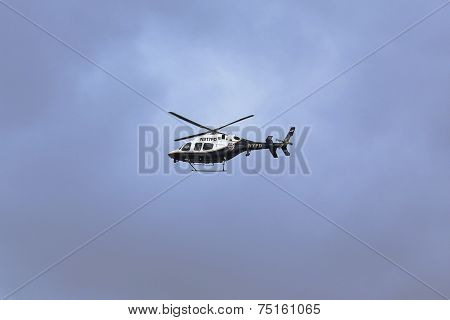 NYPD Bell 429 helicopter in the sky providing security during New York City Marathon start