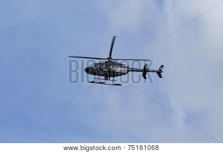 Bell 407 helicopter in the sky during New York City Marathon start