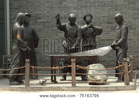 sculpture with image of ancient chinese people in life