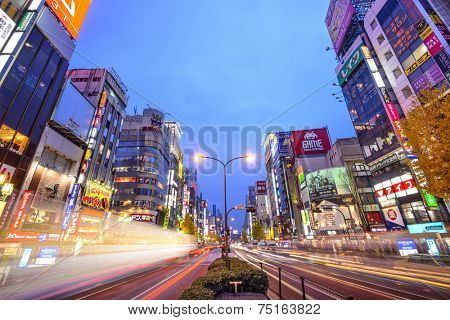 TOKYO, JAPAN - DECEMBER 15, 2012: Traffic passes through Shinjuku at Kabuki-cho. The area is a famed nightlife district.