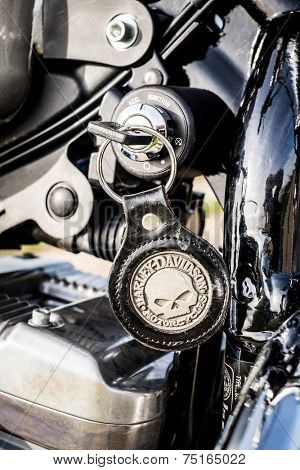 RUSSIA-JULY 7, 2013: Harley-Davidson ignition key skull Sportster 883. Harley-Davidson sustains a large brand community which keeps active through clubs, events, and a museum.