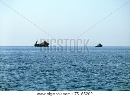 Warship sailing in still water