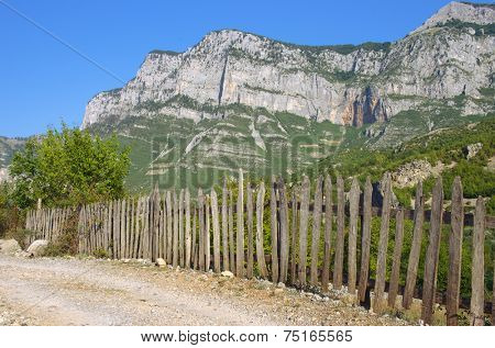 typical picket fence along a road of the Kelmend district between the Albanian Alps
