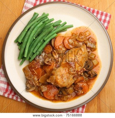 Chicken casserole served with green beans.