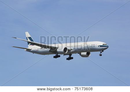 Cathay Pacific Boeing 777 in New York sky before landing at JFK Airport