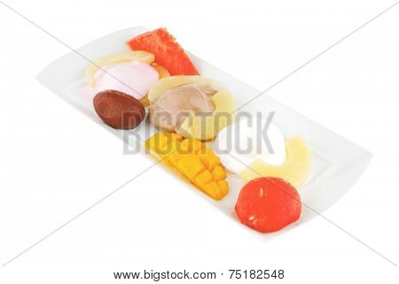 fresh tropical fruits and ice cream on white
