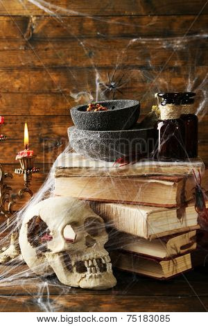 Frightful still life for Halloween, on wooden background