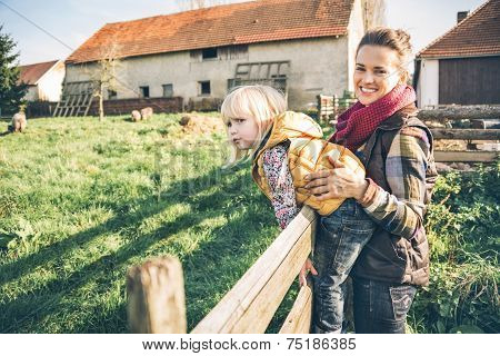 Portrait Of Happy Mother And Child On Farm