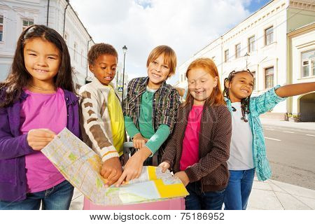 Group of international kids standing with luggage