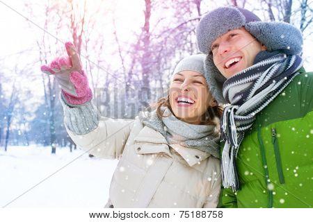 Winter couple. Happy Couple Having Fun Outdoors. Snow. Winter Vacation. Outdoor