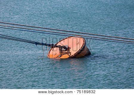 Metal Barrel Mooring In Blue Water