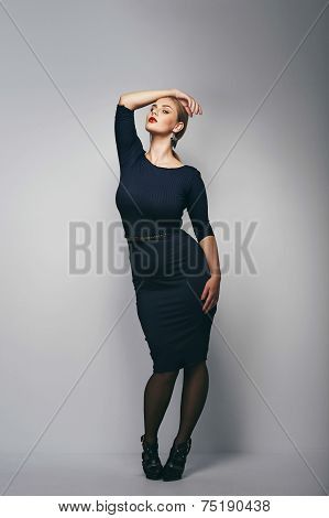 Plus Size Female Model Posing In Dress