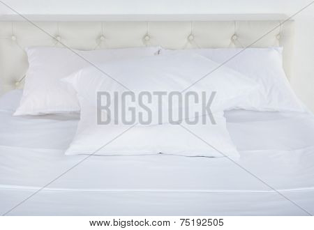 White pillows on bed in room