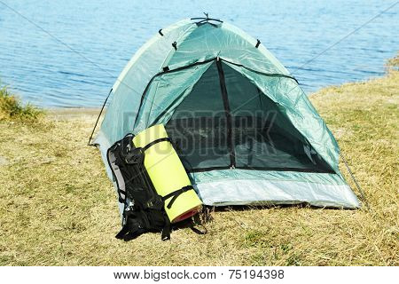 Touristic tent on dried grass near the sea