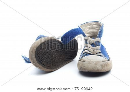 Pair Of Dirty, Worn Out Blue Children Sneakers