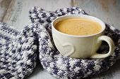 picture of outerwear  - warm wool scarf and coffee cup on old wooden table - JPG