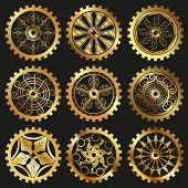 foto of steampunk  - Vector golden gears set in the style of steampunk - JPG