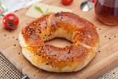 picture of bagel  - Close up of traditional Turkish bagel acma with cheese and tomatoes - JPG