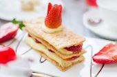 image of cream puff  - Mille feuille puff pastry layered with strawberries and whipped cream in Tea set - JPG