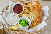 foto of potato chips  - Fish and chips set with fried potato and sauce