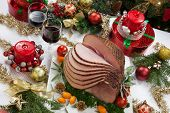 picture of kumquat  - Christmas dining table with glazed roasted ham with tomatoes herbs and kumquats - JPG