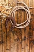 pic of lasso  - American West still life with old horseshoe and cowboy lasso - JPG