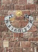 picture of sundial  - Beautiful historic sundial on the stone wall - JPG