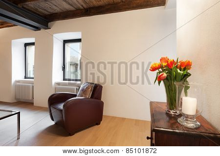 Architecture, comfortable loft furnished, room with armchair