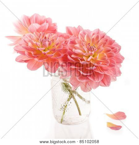 Summer dahlia bouquet in a glass jam jar bouquet.