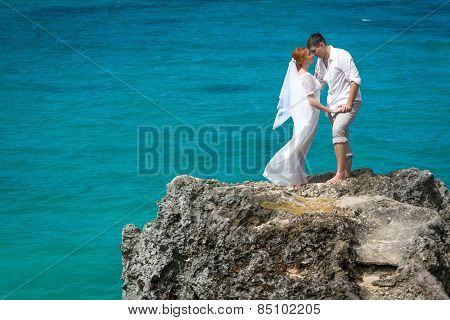 young loving couple on sea background, wedding day, outdoor beach wedding