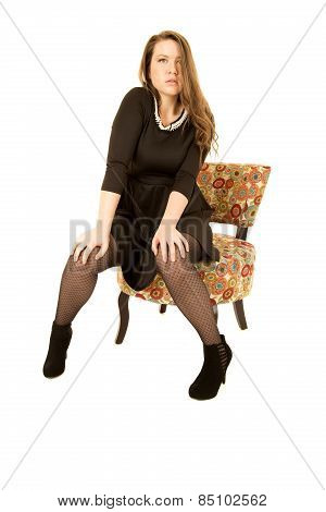 Sultry Brunette Young Woman Sitting In A Floral Chair