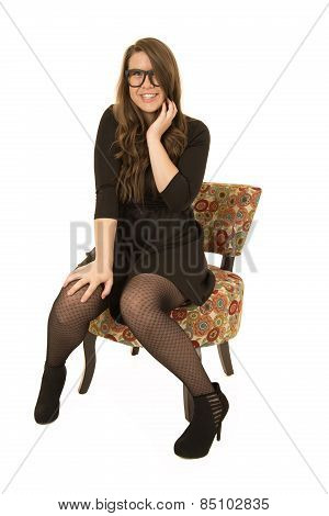 Younger Female Model Sitting In A Floral Chair