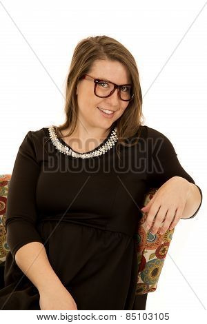 Brunetter Model Wearing A Black Dress And Cheesy Glasses