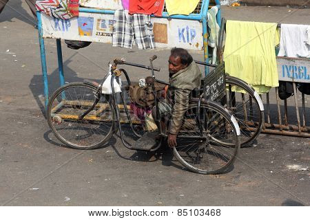 KOLKATA, INDIA - FEBRUARY 10, 2014: Beggars in front of Nirmal, Hriday, Home for the Sick and Dying Destitutes, established by the Mother Teresa and run by the Missionaries of Charity