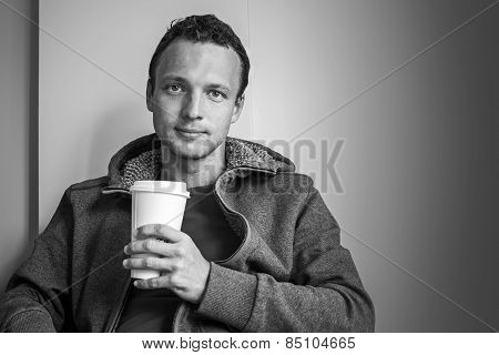 Portrait Of Young Caucasian Man Sitting In Cafe