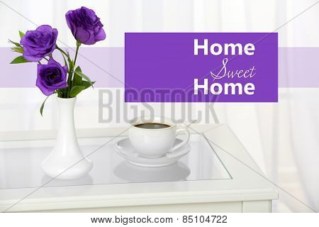 Beautiful bouquet of flowers in vase on window background and space for your text