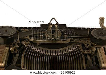 An old fashioned typewriter with the Words The End. Closeup of the antique machines ribbon and carriage.