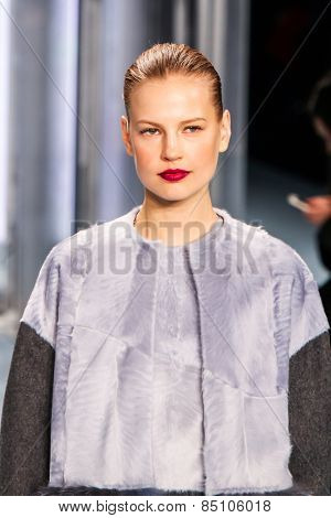 NEW YORK - FEBRUARY 16: A model walks the runway at the Carolina Herrera Fall/Winter 2015 collection during Mercedes-Benz Fashion Week in New York on February 16, 2015.