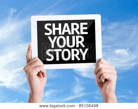 Tablet pc with text Share Your Story with sky background