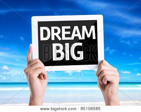 Tablet pc with text Dream Big with beach background