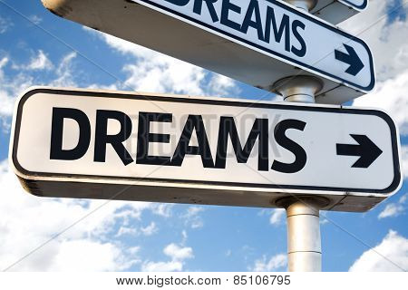 Dreams direction sign on sky background