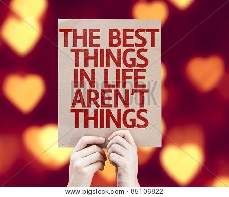 The Best Things in Life Aren't Things card with heart bokeh background