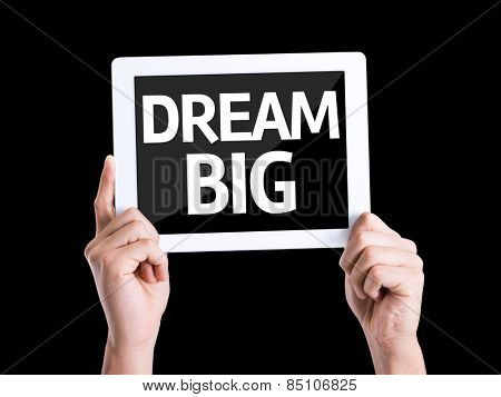 Tablet pc with text Dream Big isolated on black background