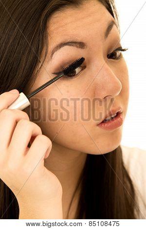 Cute Teen Girl Putting On Her Mascara