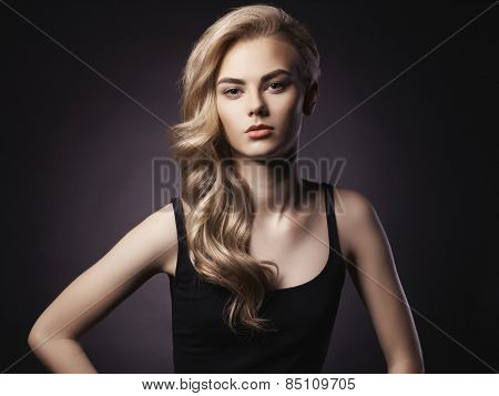 Studio fashion portrait of young beautiful lady