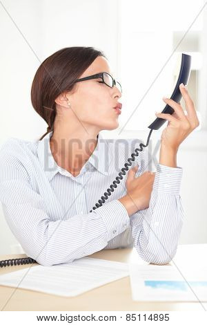 Adult Female Executive Kissing To The Phone