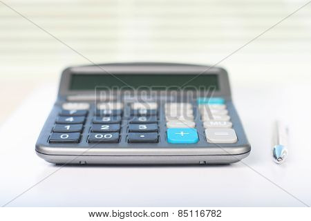 Calculator on a white table