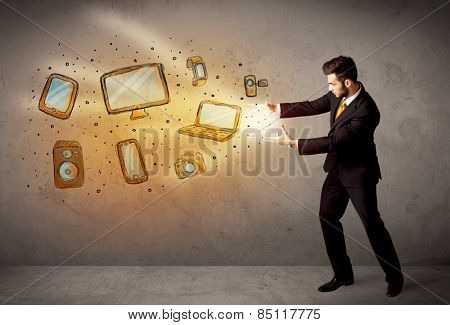 Man throwing hand drawn electronical devices concept