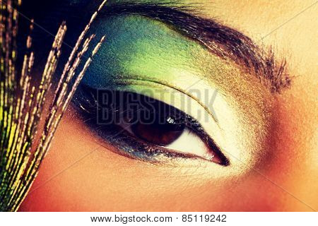 Beauty woman with artistic eye make up.