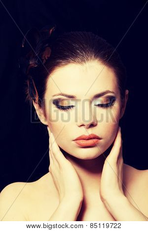 Beautiful woman with brown professional make-up.